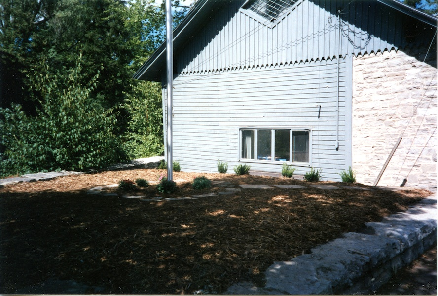 Headquarters flagpole, garden (1995)